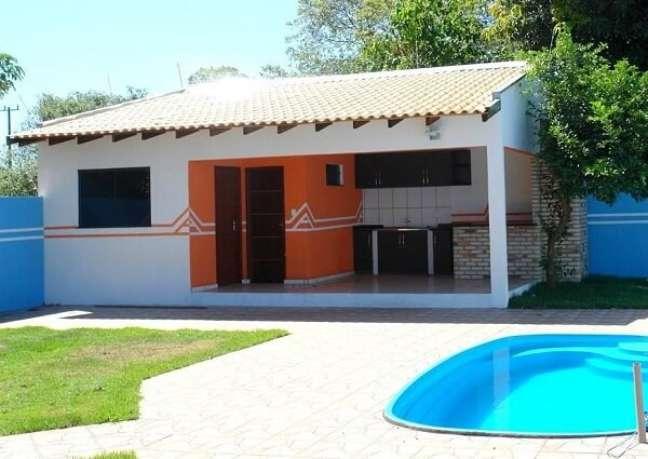 23. O tom laranja traz um destaque especial para a área da edícula simples. Fonte: Casa e Construção