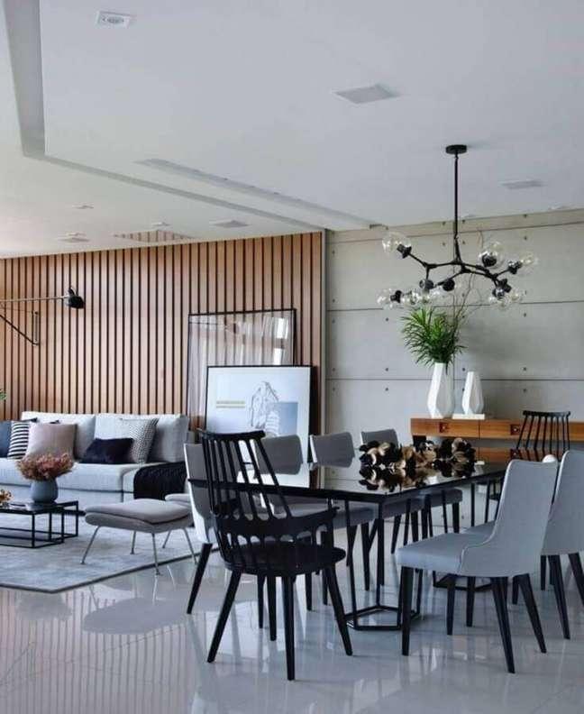 46. Parede de madeira para decoração de sala de estar e jantar integradas modernas – Foto: Futurist Architecture