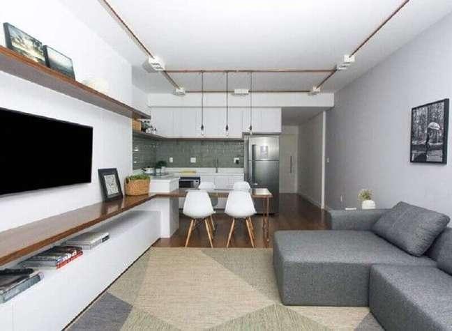 58. Tapete geométrico para decoração de sala de estar e jantar integrada – Foto: SP Estúdio