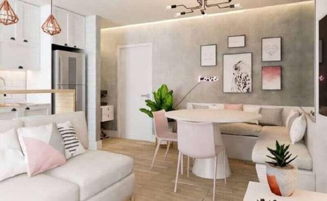 44. Parece de cimento queimado para decoração de sala de estar e jantar integradas pequenas – Foto: Irmãos Oliveira Interiores