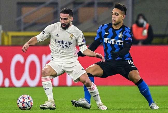 Inter de Milão e Real Madrid estiveram no mesmo grupo na última Champions League (Foto: MIGUEL MEDINA / AFP)