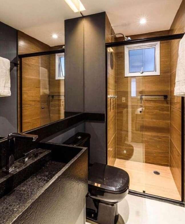 54. Revestimento amadeirado para decoração de banheiros pequenos e bonitos – Foto: CW Arquitetura e Design
