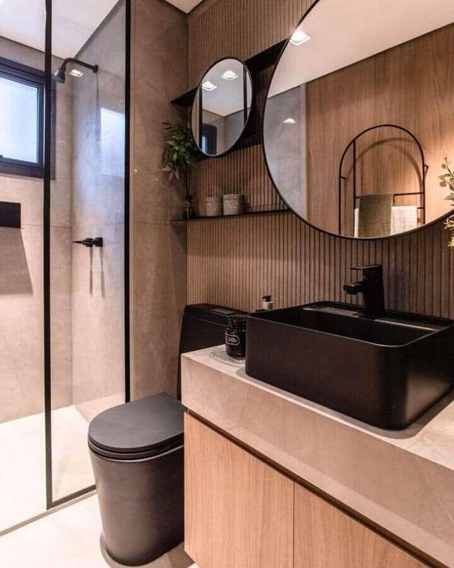 45. Painel ripado para banheiro bonito e moderno decorado com parede de cimento queimado na área do box – Foto: Claudia Albertini