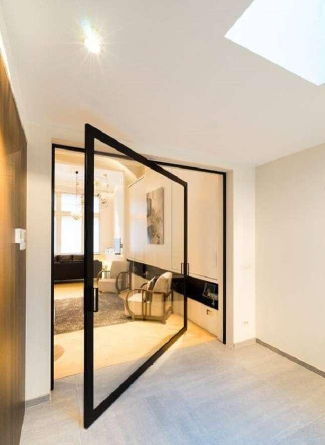 28. Modelo de porta de vidro para sala com design pivotante. Fonte: Archello