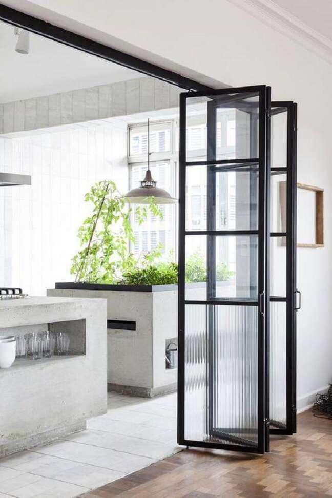 45. Porta de vidro para sala simples separa ambientes do projeto. Fonte: Casa Vogue