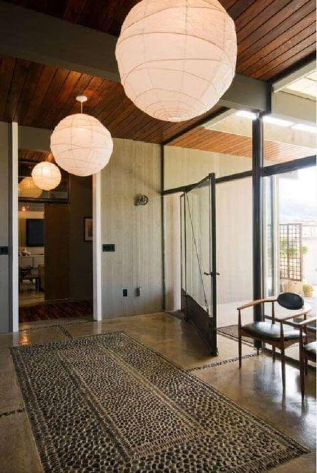 15. A porta de vidro para sala garante uma boa iluminação natural. Fonte: Pearson Design Group