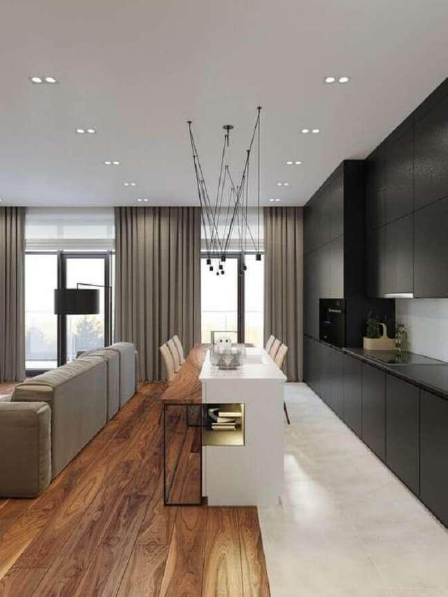 59. Sala e cozinha americana integradas decoradas com armários pretos e e ilha central – Foto: Futurist Architecture