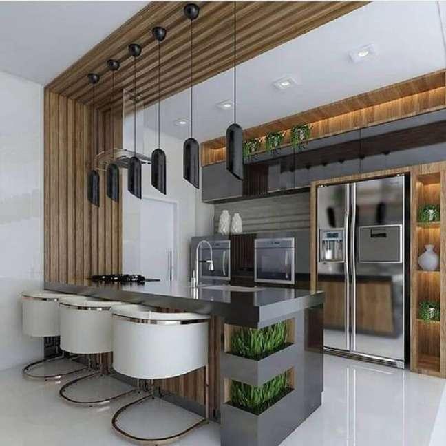 20. Cadeira moderna para decoração de casa com sala e cozinha americana planejadas – Foto: Arkpad
