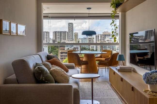 2. Sala de estar, sala de jantar e varanda foram integradas no projeto. Foto: André Nazareth