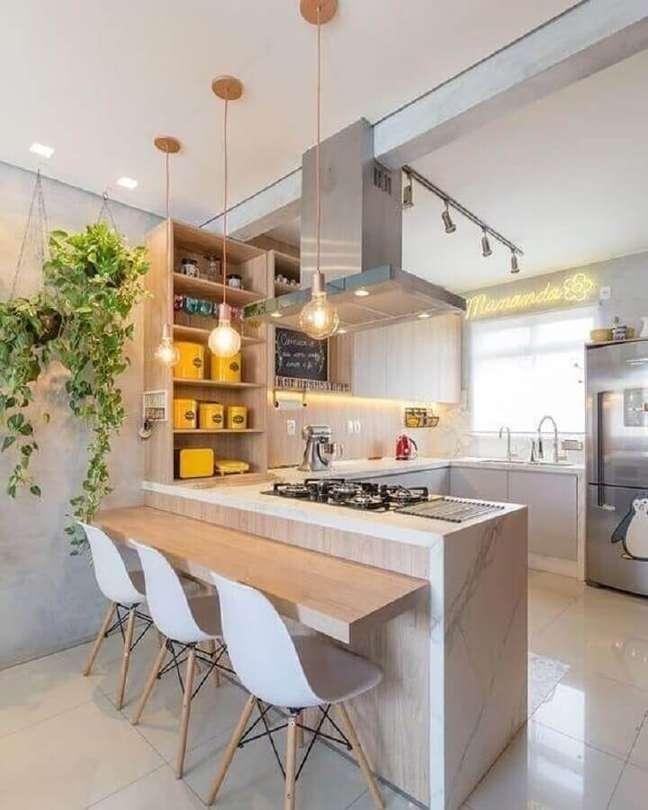 9. Bancada de madeira para decoração de cozinha e sala americana integradas – Foto: Arkpad