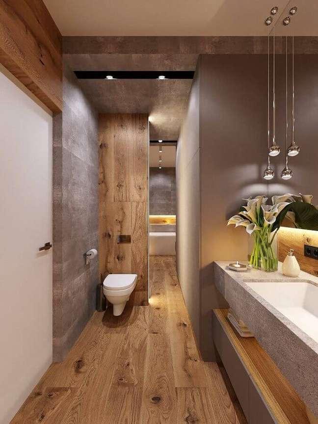 35. Decoração moderna com cimento queimado para banheiro com piso de madeira – Foto: Behance