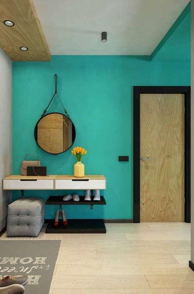 49. Parede cor ciano para hall decorado com aparador suspenso – Foto: Decor Fácil