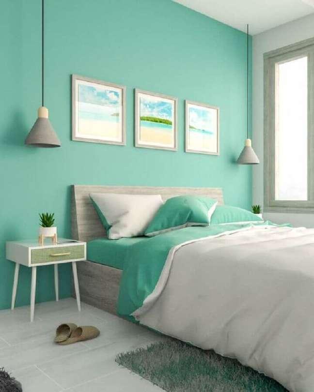 47. Parede cor ciano para decoração de quarto de casal com luminária pendente cinza – Foto: Interior Design Ideas