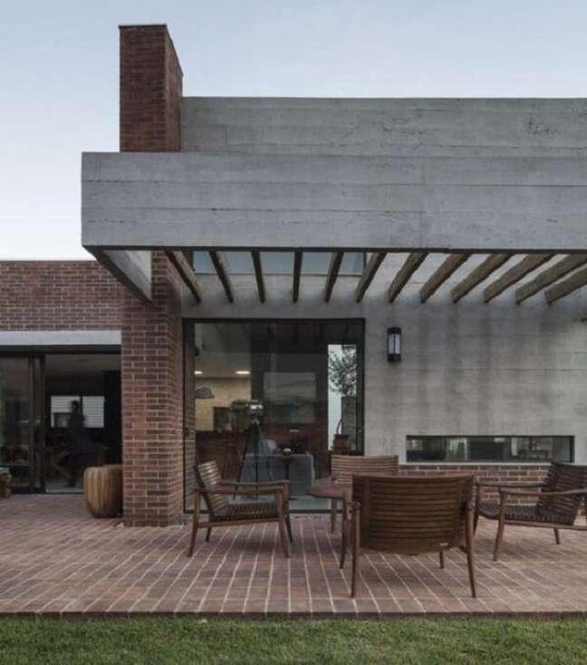 26. Casa moderna com pergolado de concreto. Fonte: Arkpad