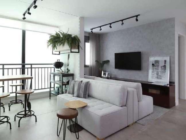 49. Vasos com plantas para decoração de sala com varanda integrada – Foto: Mandril Arquitetura