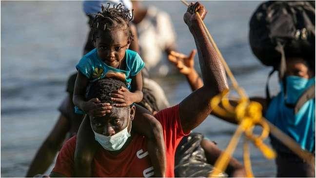 Haitianos dizem não querer voltar a seu país