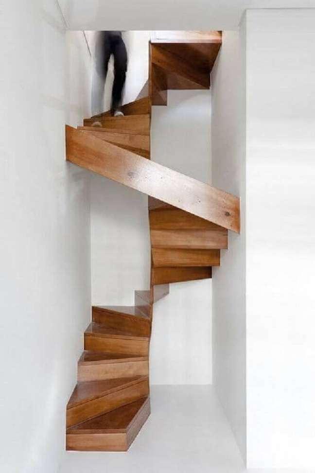53. Modelo de escada caracol de madeira com design moderno e minimalista. Fonte: Archzine