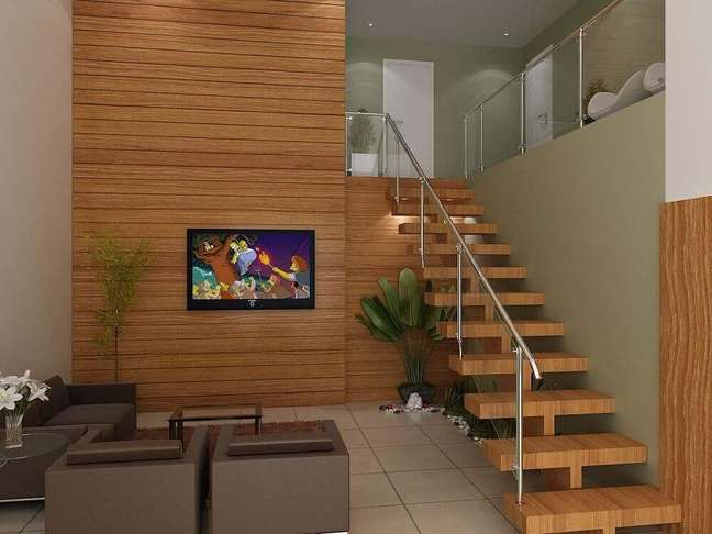 32. Escada de madeira para sala com corrimão de inox. Fonte: Mirza Talib