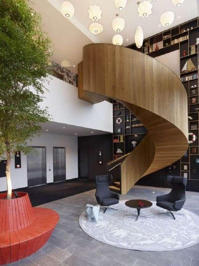 5. Modelo de escada caracol de madeira com linhas modernas. Fonte: Archilovers