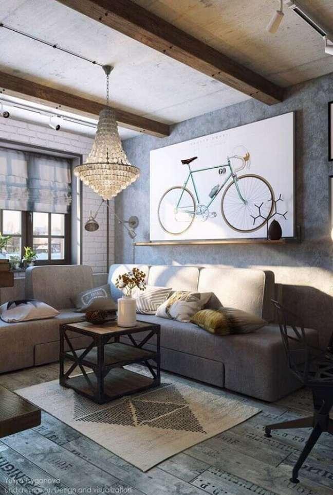 30. Lustre antigo para decoração de sala rústica com parede de cimento queimado – Foto: Mandred Metal Roofs