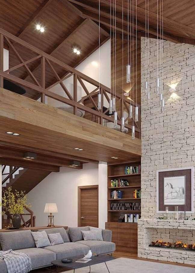 2. Mezanino de madeira para sala rústica decorada com revestimento de pedra – Foto: Architecture Art Designs