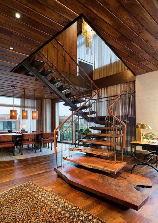 69. Decoração rústica com escada de madeira. Fonte: Gazeta do Povo
