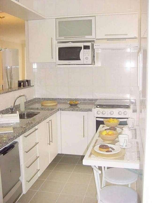 33. Decoração de cozinha simples e planejada. Fonte: Decorei.org