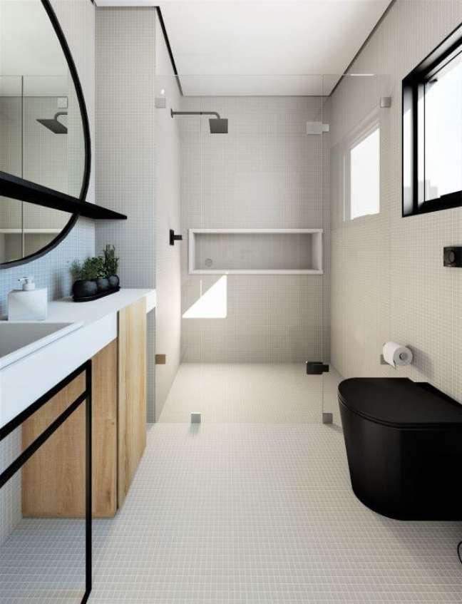 4. Banheiro cinza com nicho de porcelanato branco em destaque – Foto Vila 133 Arquitetura