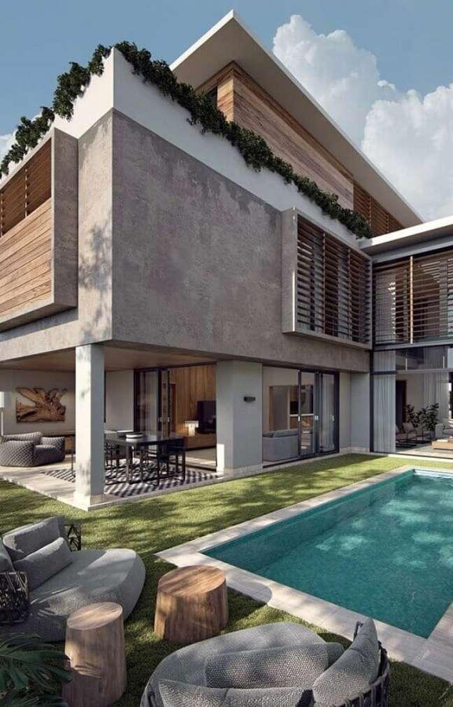 26. Cores de casas modernas externas com detalhe em cimento queimado – Foto: Dekostile