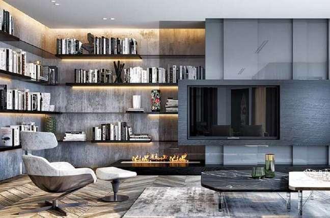 44. Cores de casas modernas para sala de TV cinza decorada com parede de cimento queimado – Foto: Futurist Architecture