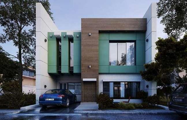 56. Fachada verde com revestimento de madeira para cores de casas modernas externas – Foto: Decor Fácil