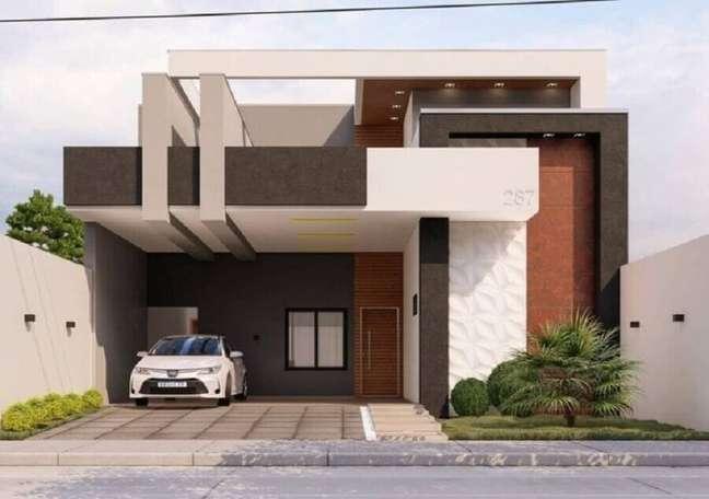 13. Cores de casas modernas para fachada cinza e branca decorada com detalhes em tons terrosos – Foto: Gambeta Engenharia e Construção
