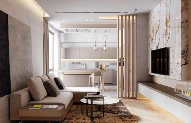 45. Cores de casas modernas para sala decorada em tons neutros com revestimento de mármore – Foto: Architizer