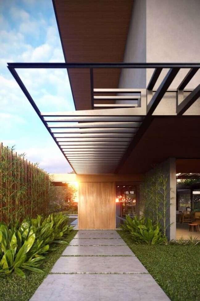 27. Cores de casas modernas externas com fachada de cimento queimado com madeira – Foto: Futurist Architecture