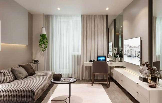 40. Cores de casas modernas para sala com home office decorada em tons neutros – Foto: Home Fashion Trend