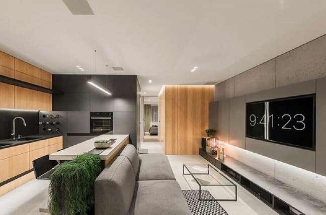 38. Cores de casas modernas para sala cinza conceito aberto decorada com detalhes em madeira – Foto: Futurist Architecture