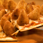 Pizza de coxinha: surpreenda-se com esse sabor