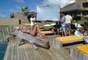 A top brasileira Izabel Goulart mostra boa forma na nova campanha da Cia Marítima