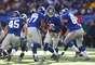 Eli Manning lanzó cinco touchdowns, la mejor cifra de su carrera, y los Giants de Nueva York vencieron 42-7 a los Eagles de Filadelfia. No obstante, los Giants quedaron fuera de los playoffs, luego que los Bears derrotasen a los Lions. (Con información de AP)