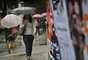 Guarda-chuva foi item obrigatório na manhã desta sexta no Rio