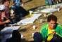 Em uma vida ditada por cores e traços, o pintor Romero Britto, nascido no Recife, completa cinquenta anos de idade neste domingo (6); seu estilo nas telas ganhou o mundo e o tornou uma das referências do Brasil no exterior. Navegue pela galeria e veja algumas de suas obras. No detalhe, Romero Britto durante a Copa de 2010, na África do Sul