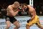 Georges St. Pierre e Johny Hendricks fizeram luta polêmica em Las Vegas que terminou com vitória para o canadense