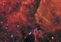 Imagem da Supernova 1987A, que pode ser vista no centro da foto. Localizada na Grande Nuvem de Magalhães, uma galáxia anã que orbita em torno da Via Láctea