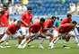 Jogadores da Costa Rica realizam aquecimento antes do jogo contra o Brasil