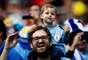 Pai e filho em Novgorod para a partida entre Uruguai e França pelas quartas de final da Copa