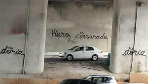 Artista é preso ao fazer protesto contra Doria em muro de SP