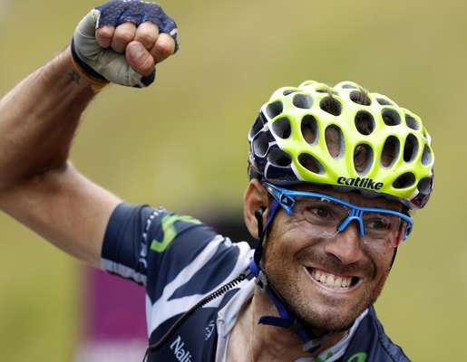 Movistar Team rider Alejandro Valverde of Spain celebrates winning the 17th stage of the 99th Tour de France cycling race between Bagneres-de-Luchon and Peyragudes, July 19, 2012. REUTERS/Stephane Mahe (FRANCE - Tags: SPORT CYCLING)