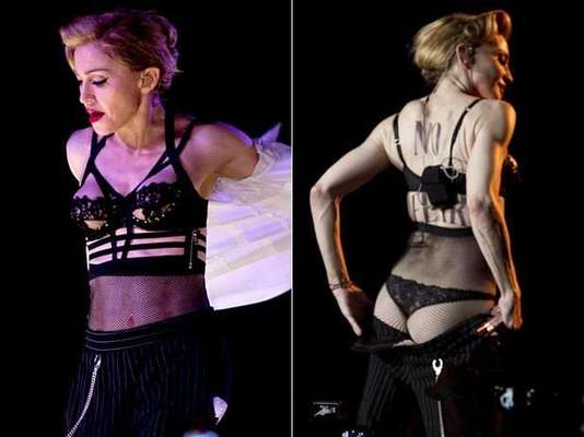Billboard has named Madonna music's biggest money maker in 2012 largely due to her 'MDNA tour' earning 34.6 millon dollars last year. Let's take a look at the Queen of Pop's more outrageously sexy moments from the tour!