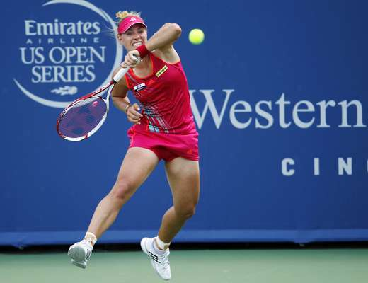 Angelique Kerber of Germany hits a return to Li Na of China in their championship match at the women's singles Cincinnati Open tennis tournament in Cincinnati, Ohio August 19, 2012. REUTERS/John Sommers II (UNITED STATES - Tags: SPORT TENNIS)