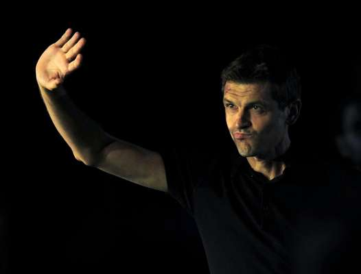 New coach Tito Vilanova greets the fans after being introduced.